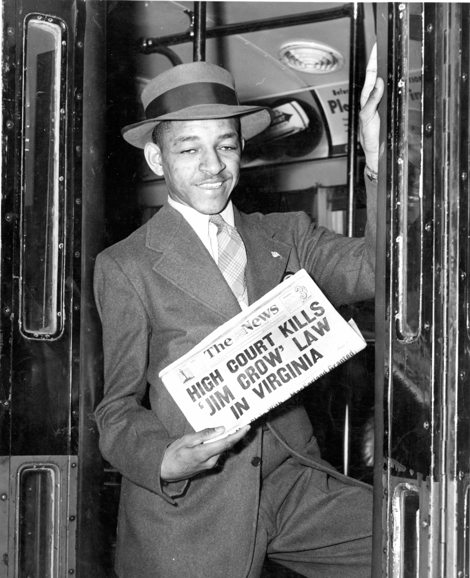 James H. Thomas, 23, of Washington D.C., boards an Arnold Bus at 12th & Pennsylvania Avenue NW for a trip to Virginia on June 4, 1946 the day after a Supreme Court ruling outlawing Jim Crow seating on interstate buses. Photo by Daily News photographer Jones: Courtesy of the DC Public Library Washington Star Collection @ Washington Post.