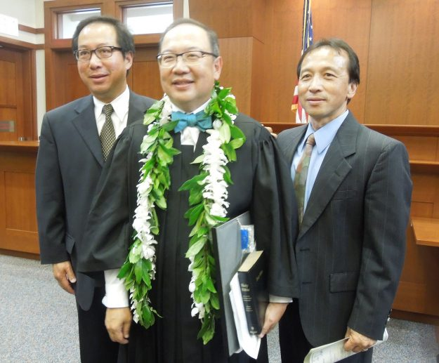 Fairfax County Circuit Court Judge John M. Tran, with brothers Tony M. Tran (left), Dr. George M. Tran (right), at his investiture, Fairfax County Courthouse, July 12, 2013. Photograph courtesy of Judge Tran.