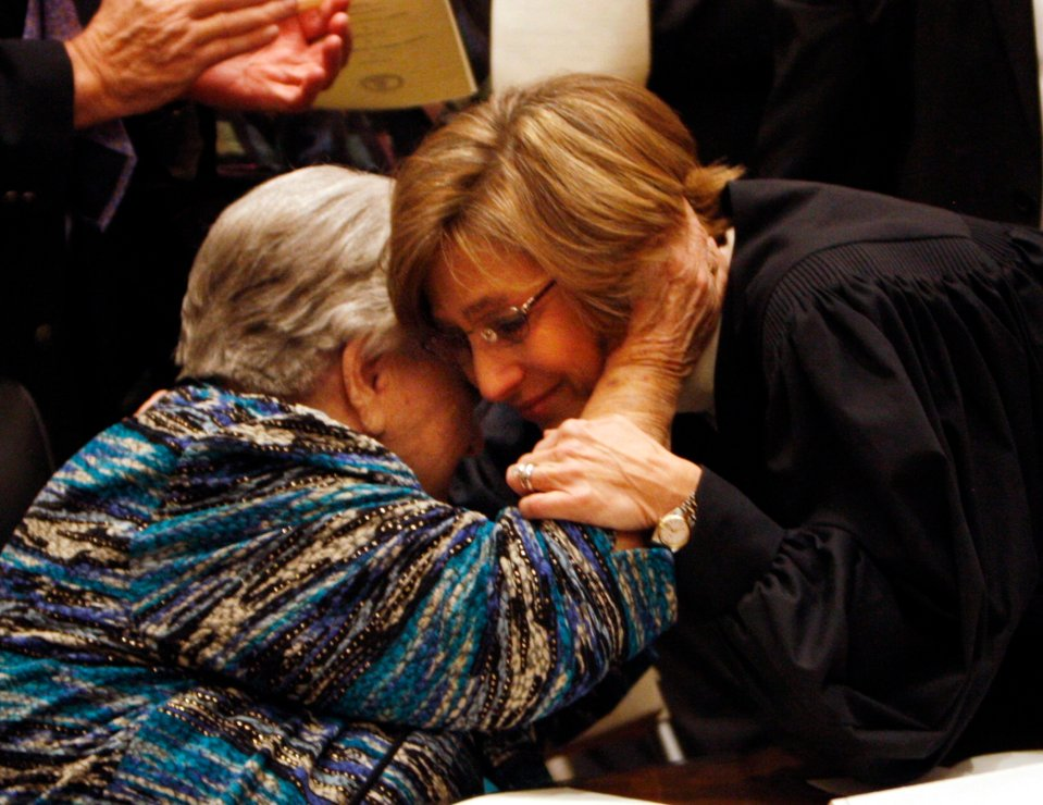 Virginia Supreme Court Chief Justice Cynthia Dinah Fannon Kinser, right, hugs her mother, Mrs. Velda M. Fannon after being sworn in at the Supreme Court Building in Richmond, VA Wednesday, February 16, 2011. AP Photo/Richmond Times-Dispatch.