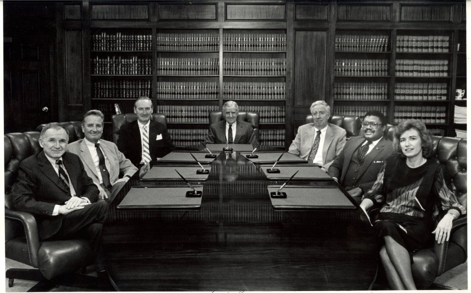 Supreme Court of Virginia, June 1989. Clockwise, left to right: Hon. Henry Hudson Whiting, Hon. Charles S. Russell, Hon. A Christian Compton, Chief Justice Harry L. Carrico, Hon. Roscoe B. Stephenson, Hon. John Charles Thomas, and Hon. Elizabeth B. Lacy. Supreme Court of Virginia Archive/Virginia State Law Library.