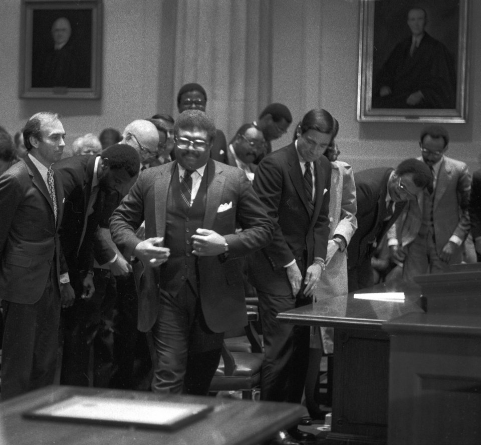 Investiture of John Charles Thomas (left) as a justice of the Supreme Court of Virginia, with Governor Charles S. Robb, April 25, 1983. Courtesy of the Richmond Times-Dispatch.